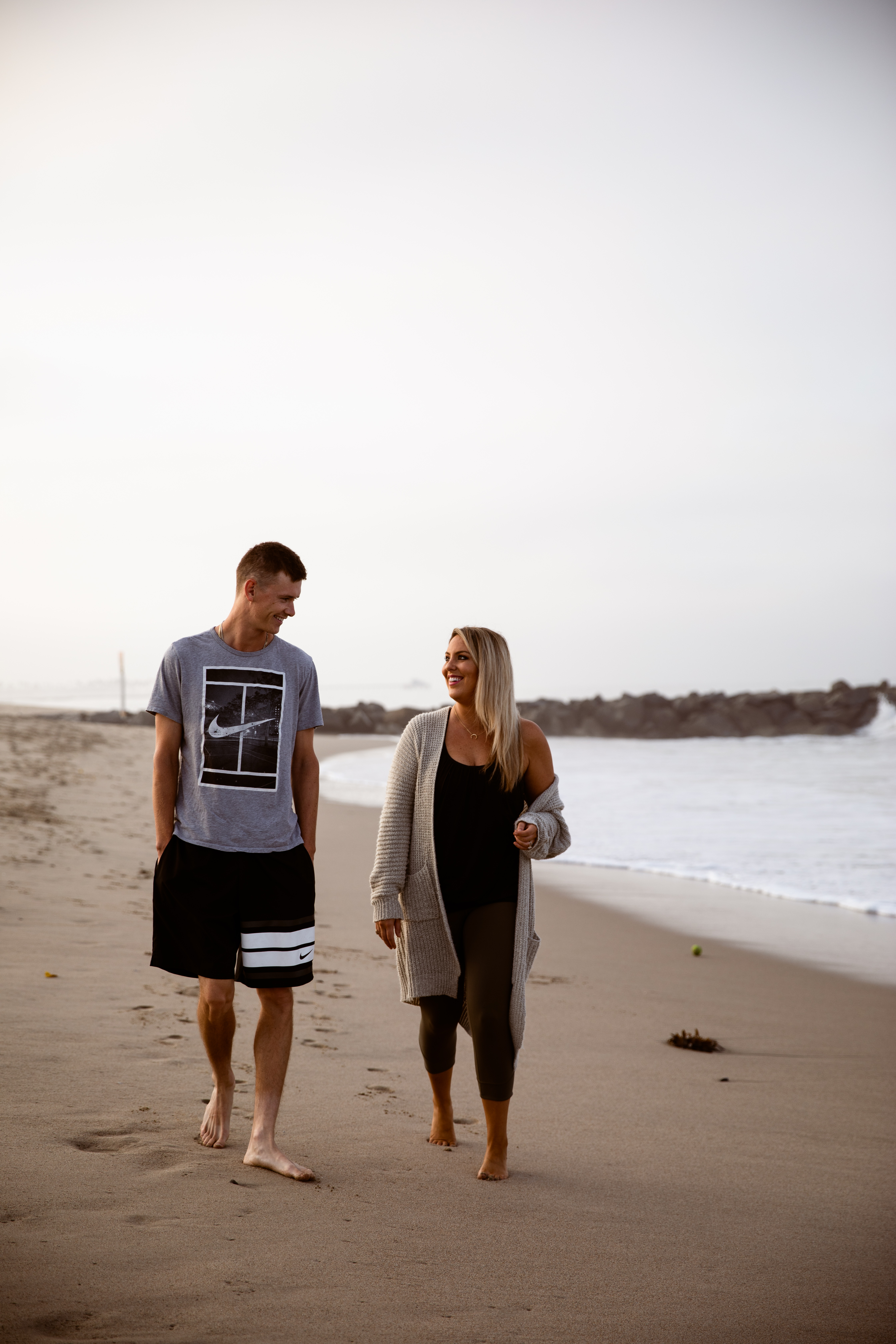 Newport Beach couple sunrise walking