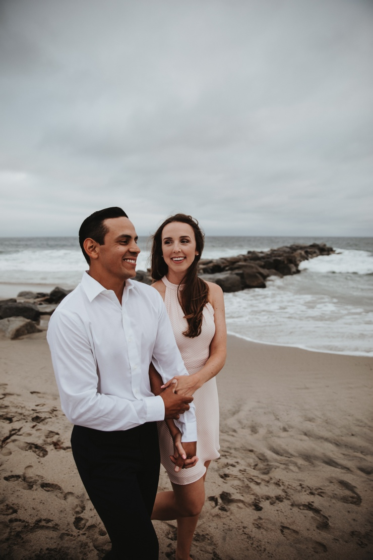 Newport Beach couple engagement photography happy walking beach smiling love